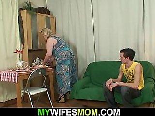 Big tits mother sucks his young cock